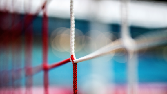 Macro of a football goal net.