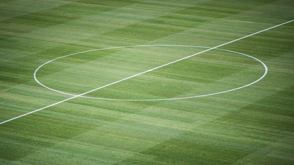 Centre circle on the pitch of a football field.