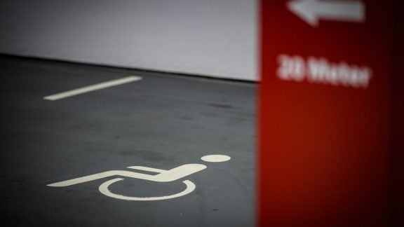 Wheelchair symbol on parking lot