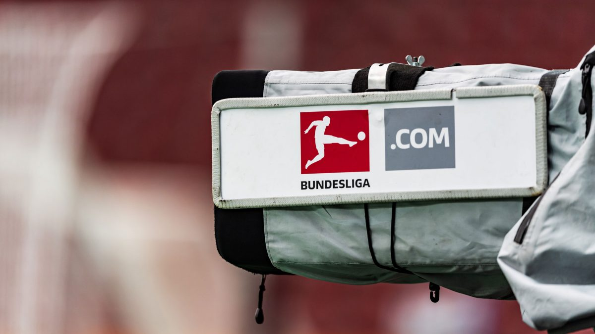 Side view on a camera in a stadium with the Bundesliga logo on it